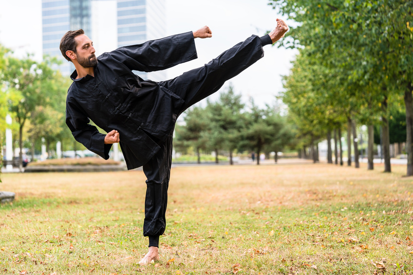 Martial artist practicing Qigong in office break